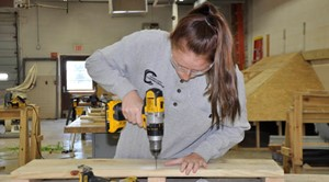 student using drill